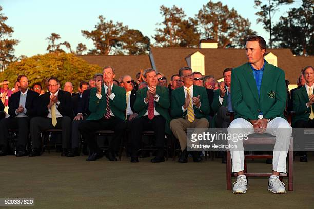 Jordan Spieth of the United States reacts after presenting Danny Willett of England with the green jacket after Willett won the final round of the...