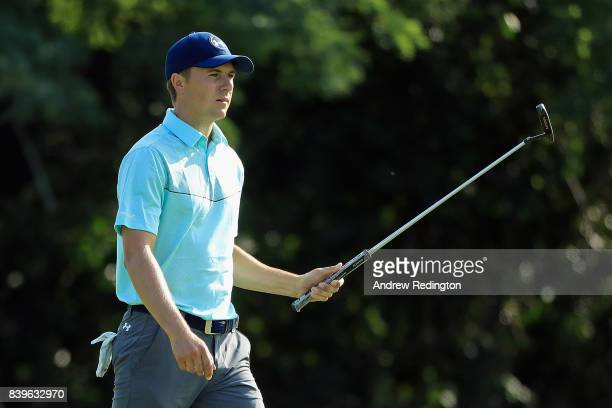 Jordan Spieth of the United States reacts after putting for birdie on the 15th green during round three of The Northern Trust at Glen Oaks Club on...