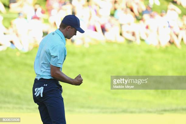 Jordan Spieth of the United States reacts after putting on the 18th green during the third round of the Travelers Championship at TPC River Highlands...