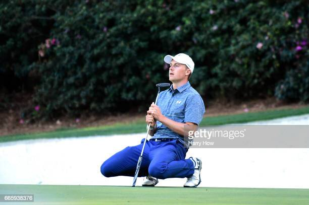 Jordan Spieth of the United States reacts on the 13th green during the second round of the 2017 Masters Tournament at Augusta National Golf Club on...