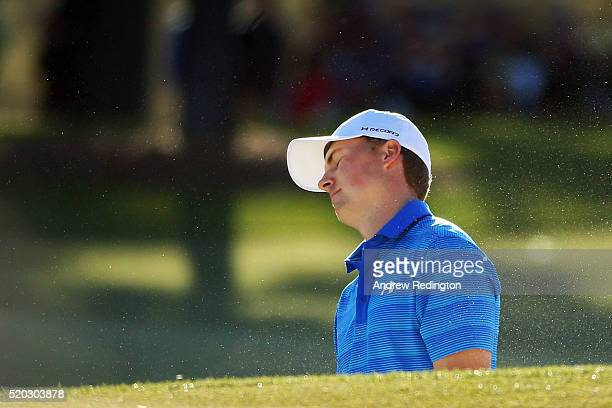 Jordan Spieth of the United States reacts on the 17th hole during the final round of the 2016 Masters Tournament at Augusta National Golf Club on...