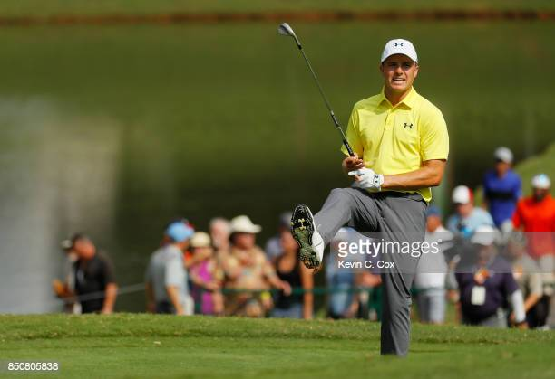 Jordan Spieth of the United States reacts on the ninth hole during the first round of the TOUR Championship at East Lake Golf Club on September 21...