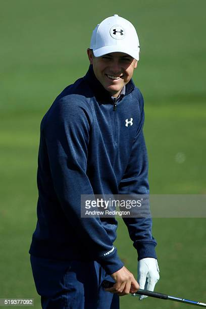 Jordan Spieth of the United States reacts on the range during a practice round prior to the start of the 2016 Masters Tournament at Augusta National...