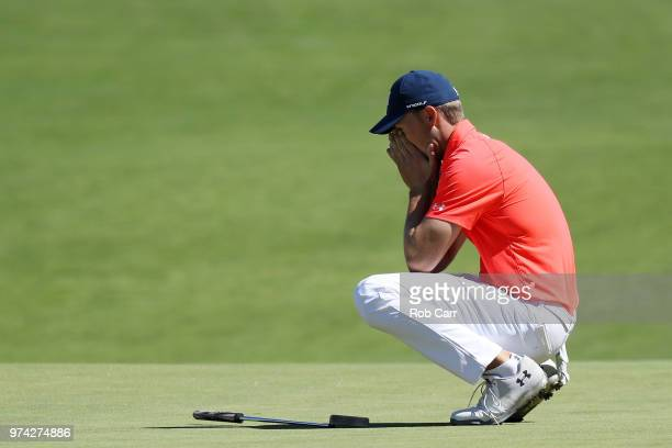 Jordan Spieth of the United States reacts to a misesd put on the 16th green during the first round of the 2018 US Open at Shinnecock Hills Golf Club...