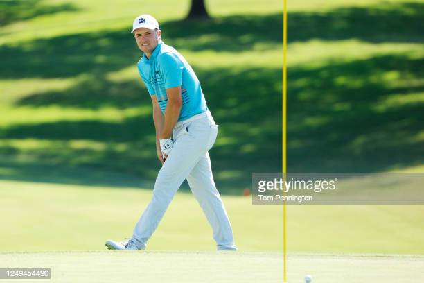 Jordan Spieth of the United States reacts to a missed shot onto the 18th green during the third round of the Charles Schwab Challenge on June 13,...