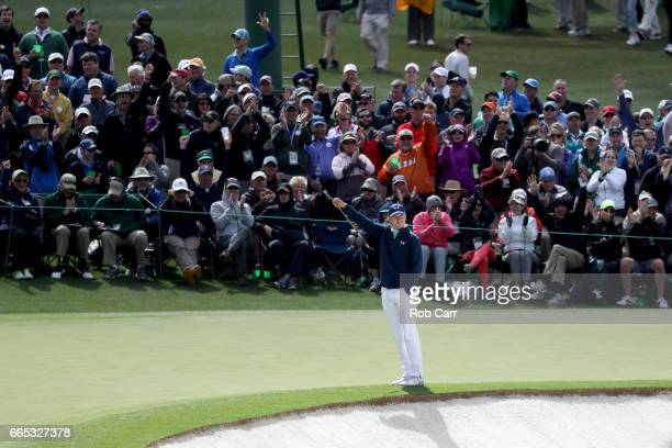 Jordan Spieth of the United States reacts to an eagle by Martin Kaymer on the second hole during the first round of the 2017 Masters Tournament at...