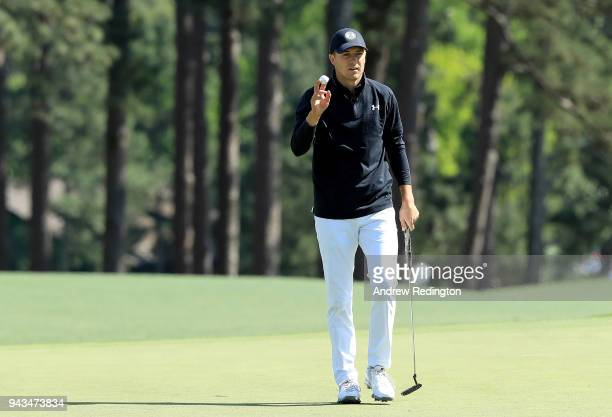 Jordan Spieth of the United States reacts to his birdie on the eighth green during the final round of the 2018 Masters Tournament at Augusta National...
