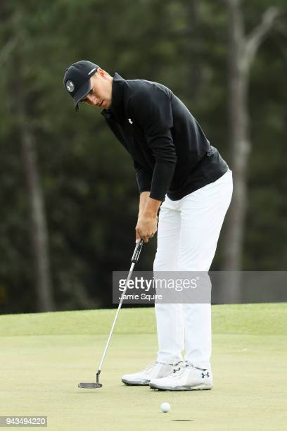 Jordan Spieth of the United States reacts to his missed putt for par on the 18th green during the final round of the 2018 Masters Tournament at...