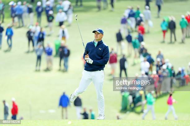 Jordan Spieth of the United States reacts to his second shot on the first hole during the first round of the 2017 Masters Tournament at Augusta...