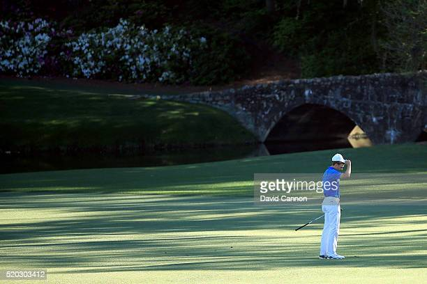 Jordan Spieth of the United States reacts to his third shot going into the water hazard on the 12th hole during the final round of the 2016 Masters...