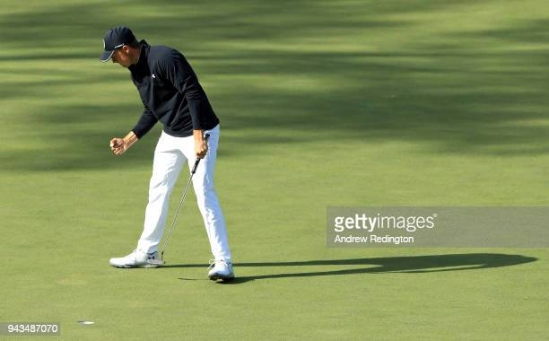 Jordan Spieth of the United States reacts to making birdie on the 15th green during the final round of the 2018 Masters Tournament at Augusta...