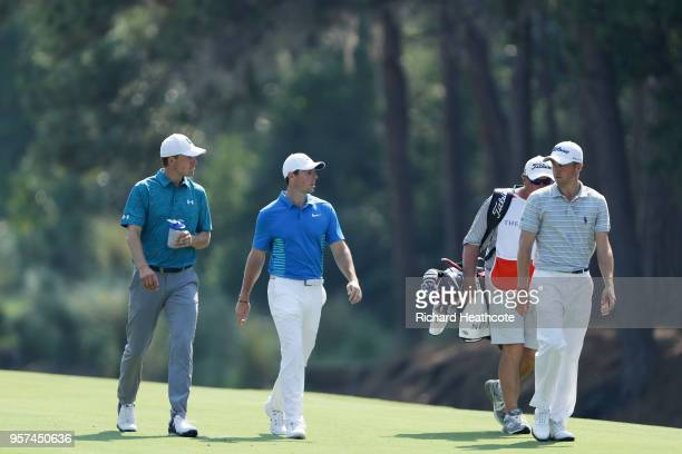 Jordan Spieth of the United States Rory McIlroy of Northern Ireland and Justin Thomas of the United States walk on the tenth hole during the second...