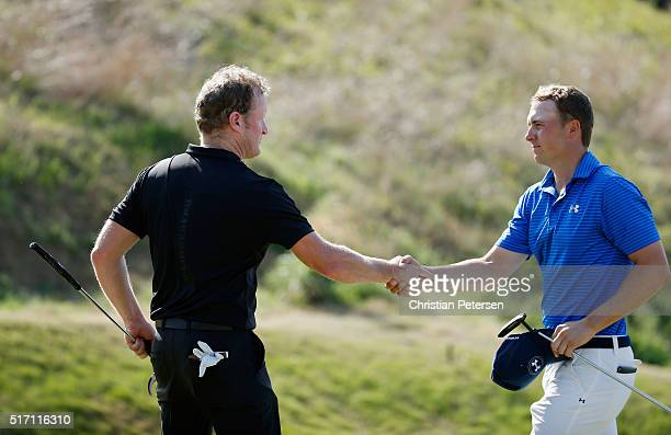 Jordan Spieth of the United States shakes hands with Jamie Donaldson of Wales after Spieth won 32 on the 16th green during the first round of the...