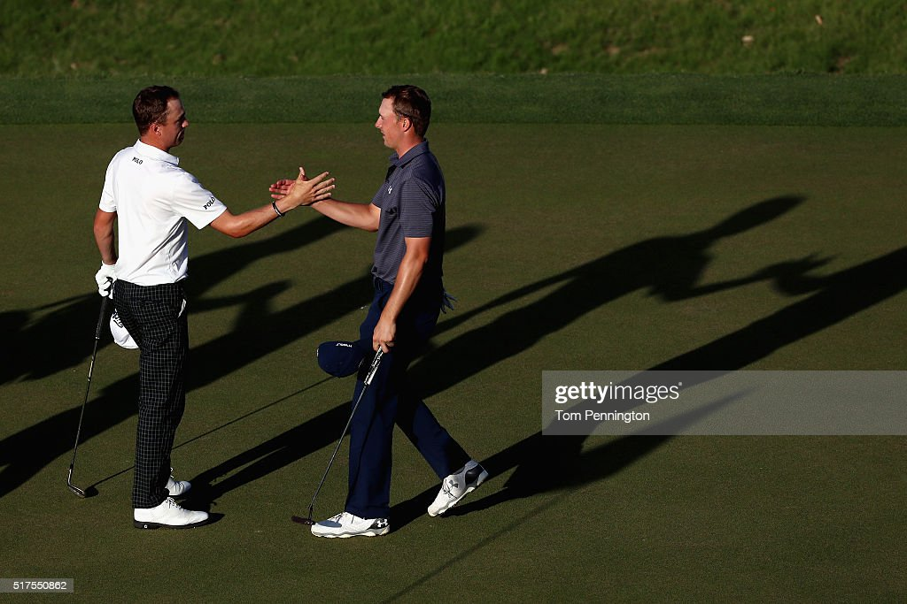 Jordan Spieth (R) of the United States shakes hands with Justin Thomas of the United States on the 16th green after Spieth won their match 3&2 during the third round of the World Golf Championships-Dell Match Play at the Austin Country Club on March 25, 2016 in Austin, Texas.