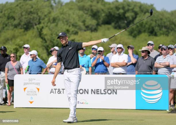 Jordan Spieth of the United States signals after hitting his tee shot on left during the second round of the 50th anniversary AT&T Byron Nelson on...