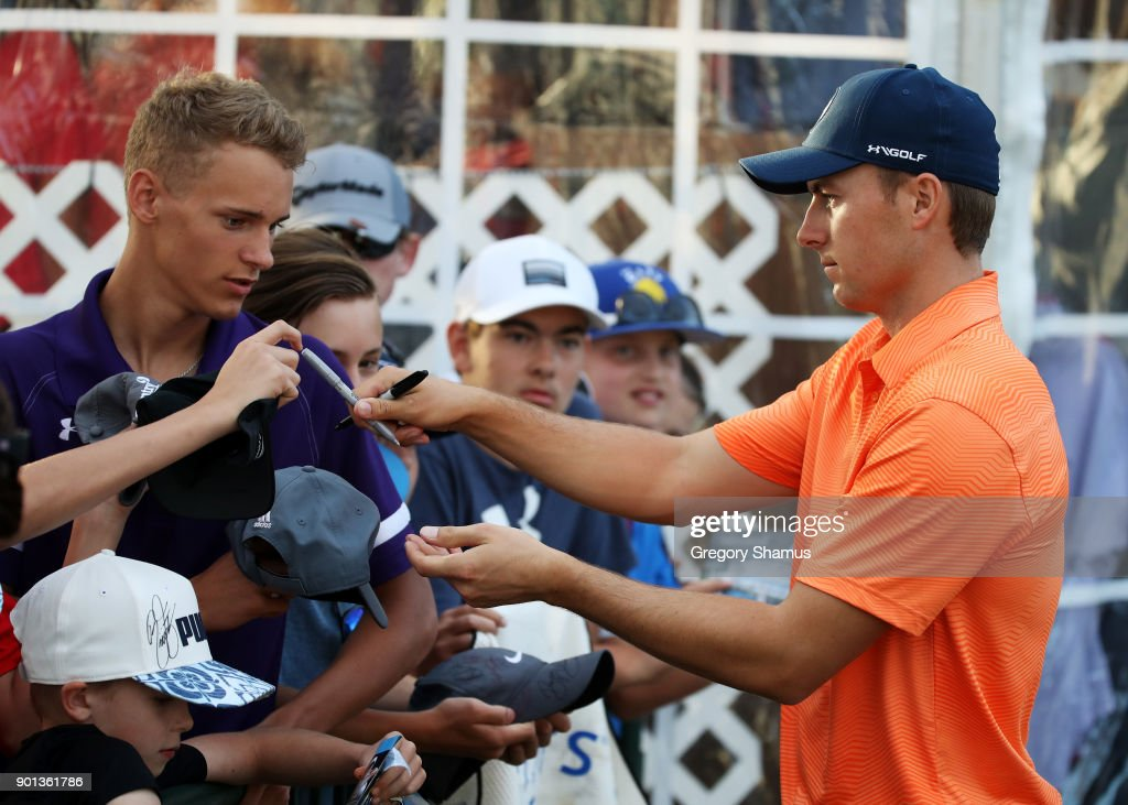 Jordan Spieth of the United States signs autographs during the first round of the Sentry Tournament of Champions at Plantation Course at Kapalua Golf Club on January 4, 2018 in Lahaina, Hawaii.