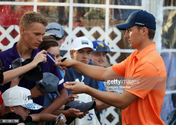 Jordan Spieth of the United States signs autographs during the first round of the Sentry Tournament of Champions at Plantation Course at Kapalua Golf...