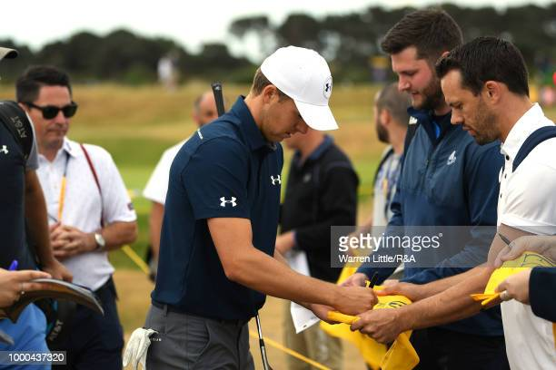 Jordan Spieth of the United States signs autographs for fans while practicing during previews to the 147th Open Championship at Carnoustie Golf Club...