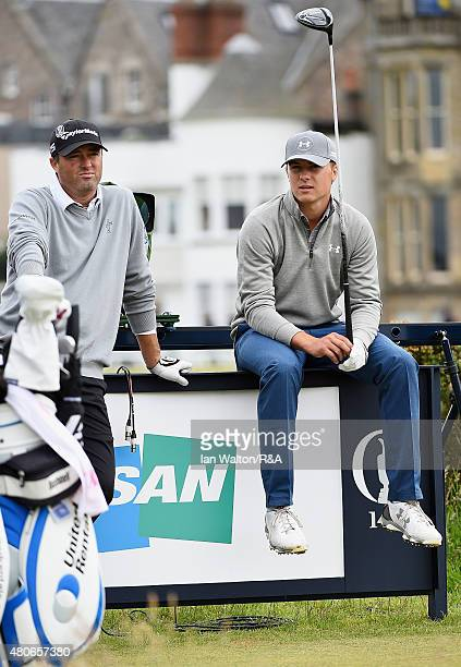 Jordan Spieth of the United States sits on a board while talking with Ryan Palmer of the United States on the second tee ahead of the 144th Open...