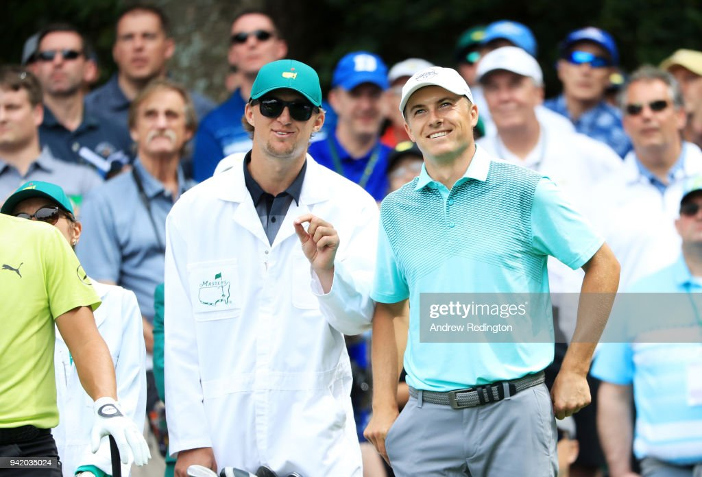 Jordan Spieth of the United States smiles alongside caddie and brother Steve during the Par 3 Contest prior to the start of the 2018 Masters Tournament at Augusta National Golf Club on April 4, 2018 in Augusta, Georgia.