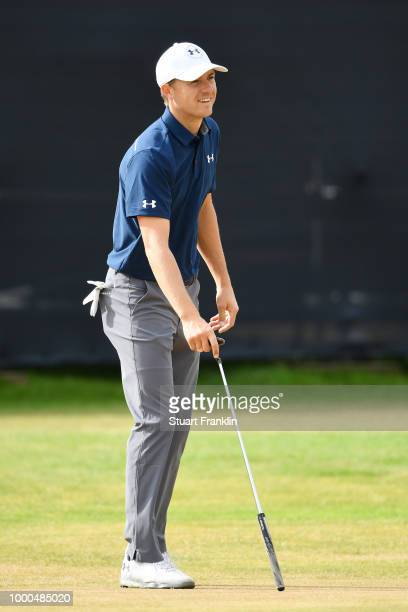 Jordan Spieth of the United States smiles as he lines up a putt on the green during previews to the 147th Open Championship at Carnoustie Golf Club...
