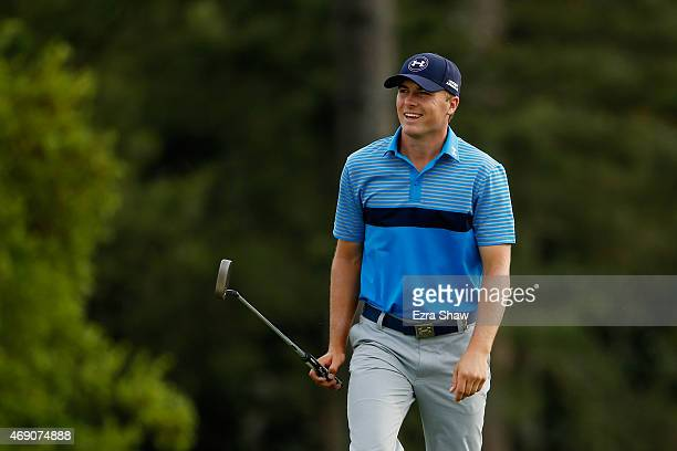 Jordan Spieth of the United States smiles as he walks to the 18th green during the first round of the 2015 Masters Tournament at Augusta National...