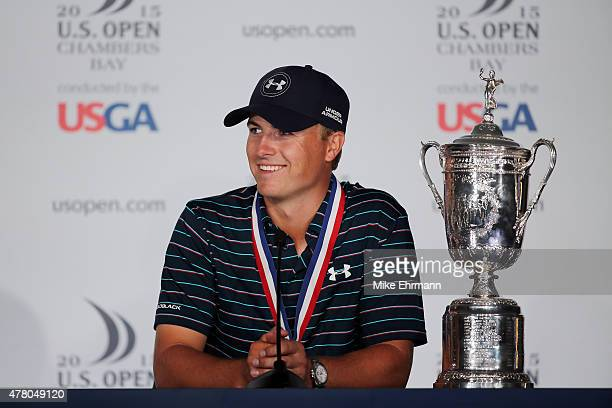 Jordan Spieth of the United States speaks with the media after winning the 115th US Open Championship at Chambers Bay on June 21 2015 in University...