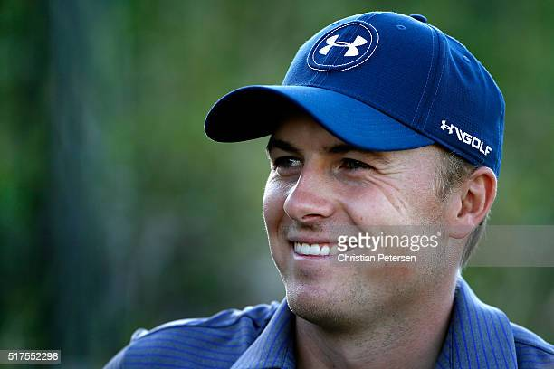 Jordan Spieth of the United States speaks with the media behind the 16th green during the third round of the World Golf ChampionshipsDell Match Play...