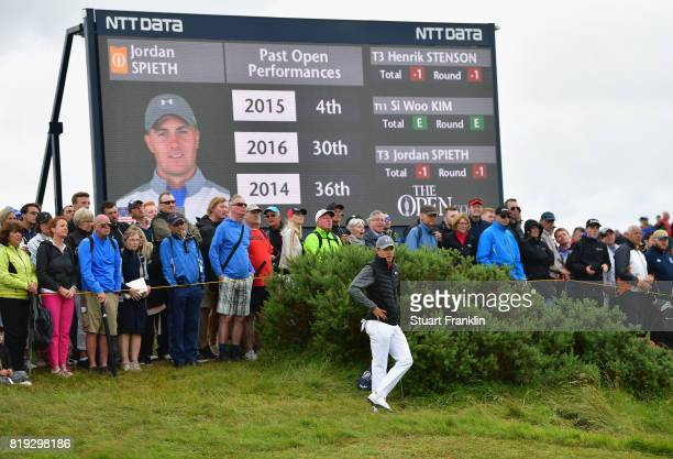 Jordan Spieth of the United States stands next to a scoreboard during the first round of the 146th Open Championship at Royal Birkdale on July 20,...