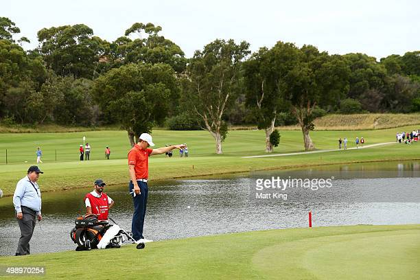 Jordan Spieth of the United States takes a drop on the 3rd hole after hitting into the water during day three of the 2015 Australian Open at The...