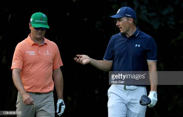 Jordan Spieth of the United States talks to Zach Johnson of the United States on the seventh hole during a practice round prior to the Masters at...