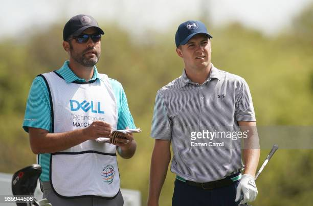 Jordan Spieth of the United States talks with his caddie Michael Greller during the first round of the World Golf ChampionshipsDell Match Play at...