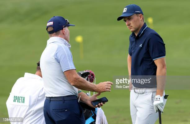 Jordan Spieth of the United States talks with swing coach Cameron McCormick during a practice round prior to the Masters at Augusta National Golf...