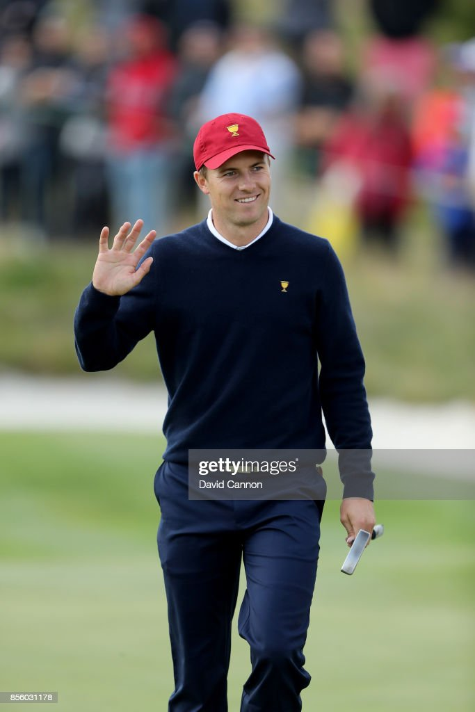Jordan Spieth of the United States team acknowledges the crowds on the 16th green in his match with Patrick Reed in tehir match against Jason Day and Louis Oosthuizen of the International team during the Saturday afternoon fourball matches in the 2017 Presidents Cup at the Liberty National Golf Club on September 30, 2017 in Jersey City, New Jersey.