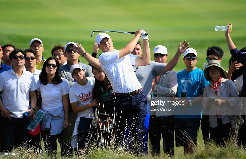Jordan Spieth of the United States Team hits a shot from the rough on the first hole during the Thursday foursomes matches at The Presidents Cup at Jack Nicklaus Golf Club Korea on October 8, 2015 in Songdo IBD, Incheon City, South Korea