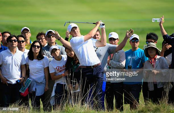 Jordan Spieth of the United States Team hits a shot from the rough on the first hole during the Thursday foursomes matches at The Presidents Cup at...