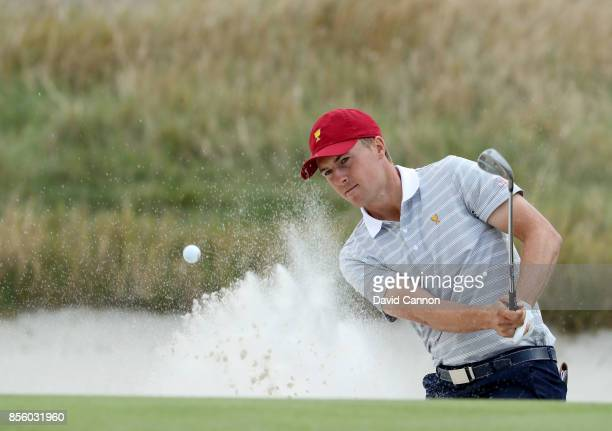 Jordan Spieth of the United States team plays his second shot on the 10th hole in his match with Patrick Reed in tehir match against Jason Day and...