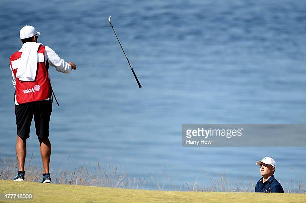Jordan Spieth of the United States tosses his golf club to his caddie Michael Greller on the 16th hole during the second round of the 115th U.S. Open...