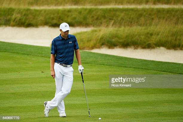 Jordan Spieth of the United States waits for play to resume after a weather delay during the first round of the US Open at Oakmont Country Club on...