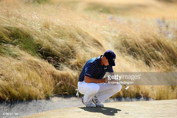 Jordan Spieth of the United States waits on the fourth green during the final round of the 115th US Open Championship at Chambers Bay on June 21 2015...