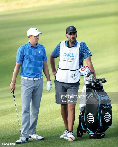 Jordan Spieth of the United States waits to play his third shot on the par 5 16th hole with his caddie Michael Greller in his match against Yuta...
