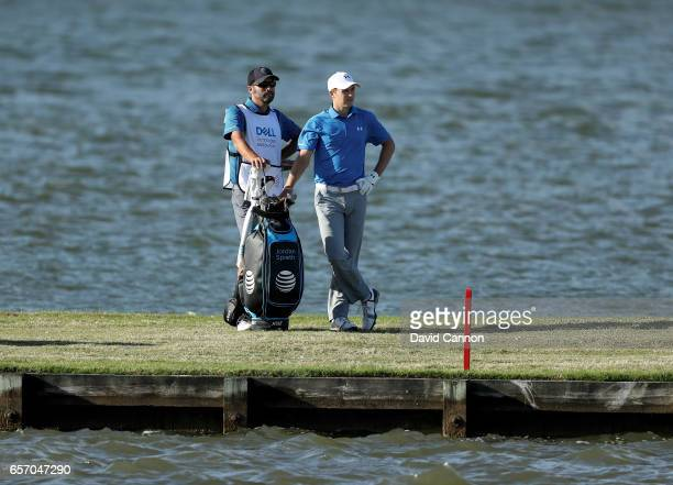 Jordan Spieth of the United States waits to play his third shot with his caddie Michael Greller on the par 4 13th hole in his match against Yuta...