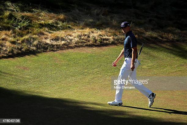 Jordan Spieth of the United States walks across the 12th green during the final round of the 115th US Open Championship at Chambers Bay on June 21...