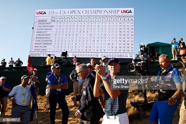 Jordan Spieth of the United States walks alongside Thomas O'Toole Jr President of the USGA after Spieth won the 115th US Open Championship at...