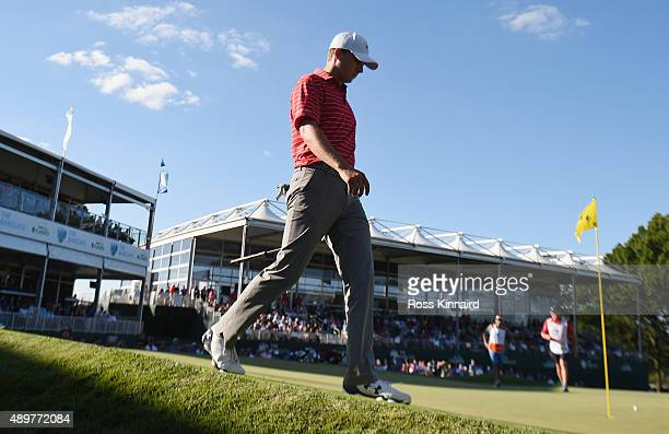 Jordan Spieth of the United States walks behind the 18th green during the second round of The Barclays at Plainfield Country Club on August 28 2015...