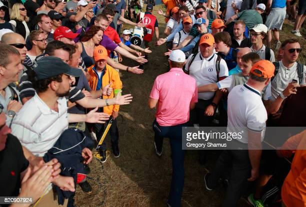Jordan Spieth of the United States walks through a corridor of fans during the third round of the 146th Open Championship at Royal Birkdale on July...