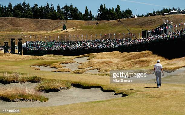 Jordan Spieth of the United States walks up the 18th fairway during a practice round prior to the start of the 115th U.S. Open Championship at...