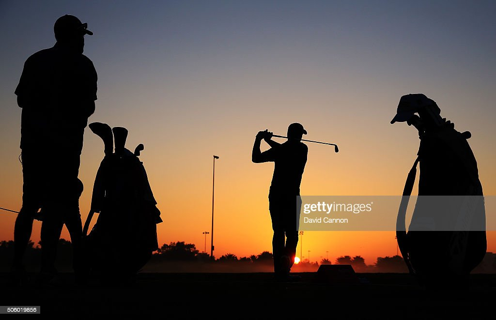 Jordan Spieth of the United States warms up on the driving range as the sun rises before the first round of the 2016 Abu Dhabi HSBC Golf Championship at the Abu Dhabi Golf Club on January 21, 2016 in Abu Dhabi, United Arab Emirates.