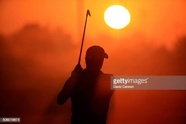 Jordan Spieth of the United States warms up on the driving range as the sun rises before the first round of the 2016 Abu Dhabi HSBC Golf Championship...