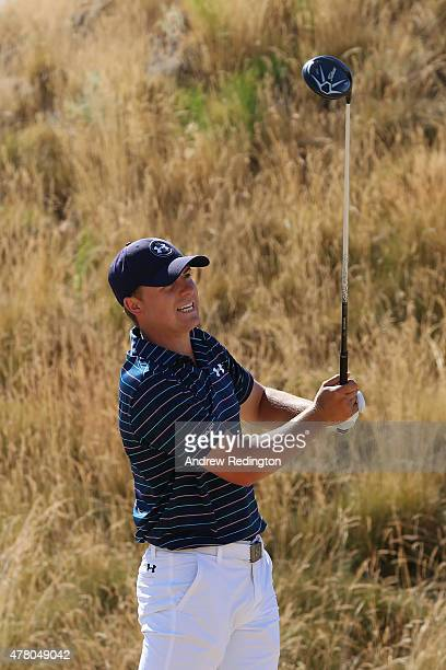 Jordan Spieth of the United States watches a tee shot during the final round of the 115th US Open Championship at Chambers Bay on June 21 2015 in...